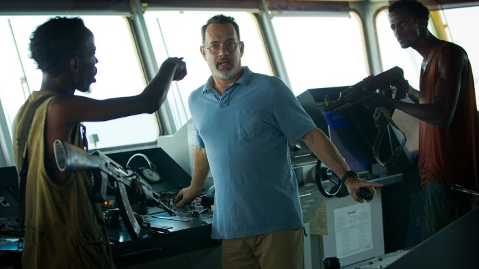 Barkhad Abdi, Tom Hanks, and Faysal Ahmed in Captain Phillips