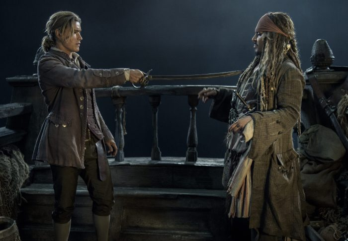 Brenton Thwaites and Johnny Depp in Pirates 5